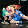 Anderson's Ty Lawler works for position against Elwood's Kayden McCray in their 220 pound match. Lawler won by pin.