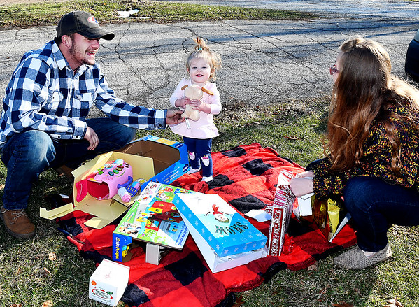 With the Wednesdays temperatures approaching 60 degrees, Stephanie Johnson and Zach Bralley decided to take their one year-old daughter Noa Bralley to Shadyside Park to have her Christmas outdoors on a warm Christmas day.