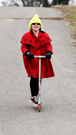 Nine year-old Chloe Gibson wanted to get outside after school and play on her scooter so now she's all smiles as she takes to the paths around Pulaski Park Wednesday afternoon to have some fun.