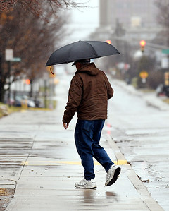 Even with the warmer temperatures, umbrellas were the order of the day as persistent rain fell over the area most all day Monday.