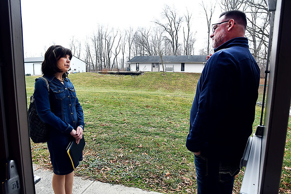Anne Hazlett, with the White House's National Drug Control Policy, looks over part of the property of the former SunRise Retreat Center with                    Darrell Mitchell, CEO Progress House Friday as Progress House and Aspire Indiana Heath proposes turning the former facility into a substance abuse recovery facility with 92 beds.