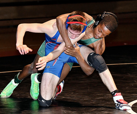 Anderson's Romello Williams gets a lock around Elwood's Jayden Reese in their match in the 113 weight class.Williams pinned Reese to win the match.