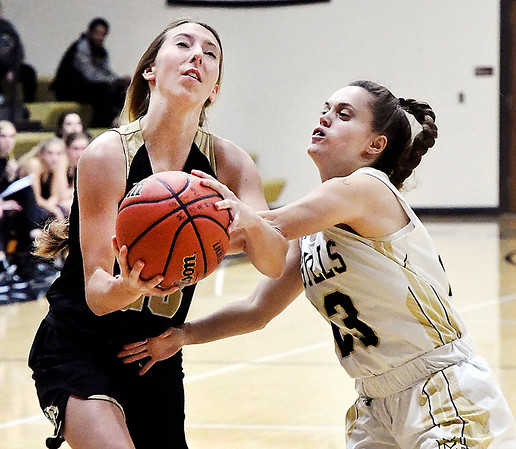 Lapel's Chloe Tucker gets fouled by Blayklee Stitt of Madison-Grant as Tucker drives to the basket.