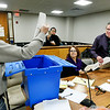 Recount Commission member Charles Parker passes out the paper ballots from one of the Anderson City Council District 5 precinct ballot boxes to commission members Tonia Wainscott and David Beeman during the District 5 recount Wednesday. Republican Art Pepelea Jr. filed for the recount last month after losing the election to incumbent Democrat Lance Stephenson by 14 votes.