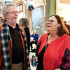 Deb Stapleton, right, has a laugh with Randy Titus Thursday afternoon during her retirement party as director of the Anderson Museum of Art. A long line of people greeted Stapleton to wish her well after serving 39 years at the museum.