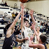 Lapel's Blake Mills lets the ball fly as he shoots between Elwood defenders.
