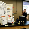 Ryan Neal explains the three prototype models of the PPA-120 Special, a small promotional train, that his Purdue Polytechnic Tech 120 Design Thinking class team has designed and built for their class project during the teams presentation to the class recently.