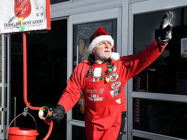 """Salvation Army bell ringer Jan Presley greets everyone with a wave and a """"Merry Christmas"""" as he works at the grocery entrance to Walmart in Anderson Tuesday."""