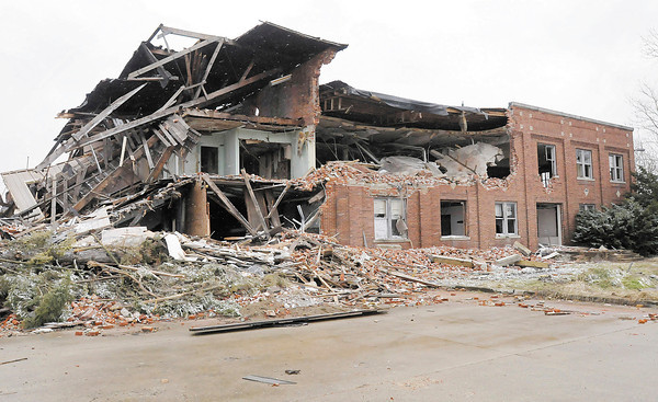 The demolition of Nicholson File is on hold but the site has been left open  raising concern among neighbors.