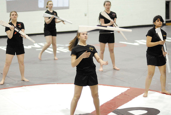 """The Anderson High School Winter Guard perform """"The Wounded"""" that is the theme of the 2013 show."""
