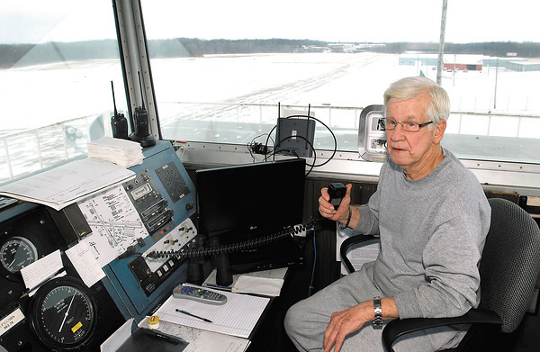 THB FILE PHOTO: John Strauser looks down the runway for an approaching plane as he works in the control tower Friday.  Strauser is the airport traffic manager.