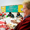 Charlene Branch reads her handmade valentine card that students from Cross Street Christian School and Anderson Elementary School made for each of the seniors that meet at the Geater Center for lunch each day.  The students also made flowers to go with the cards for everybody.