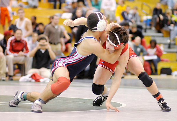 Elwood's Sammy Mireles wrestles Lawrence North's Joe Fowler in the 170 pound championship during the wrestling regional at Pendleton Heights on Saturday. Mireles won be decision.