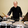 ASO percussionist Dave Robbins gets things set up for the symphony's upcoming concert Saturday .