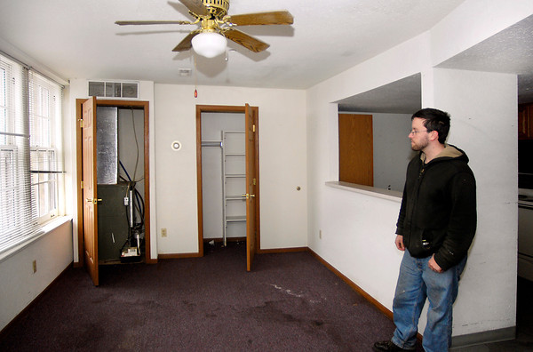 Elliott Hunt of Greenfield looks over this 12th floor apartment in the Tower Apartment building Monday during their open house.