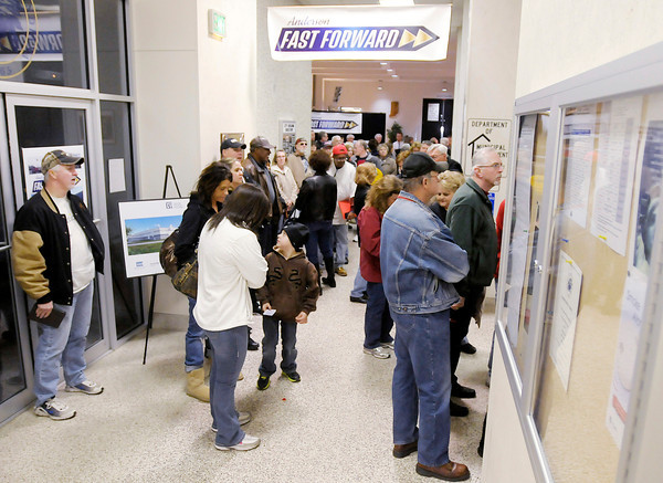 A large crowd spills out of the City Council chambers and into the hallway during Thursday's City Council Meeting. On the agenda was a presentation on a plan to annex approximately 21 square miles of land.