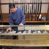 Crack Shot Guns owner Mike Clevenger arranges what guns he has in stock in his display case.  Clevenger says he has been selling the guns has fast has he gets them in.