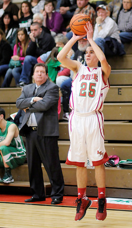 Anderson's Grant Bennett scores from three-point range for the Indians as they hosted the New Castle Trojans on Friday.