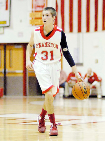 Austin Compton brings the ball downcourt for the Eagles.