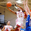 Anderson senior Jalen Beard goes in for a lay up during the Indians home game against Chatard High School.