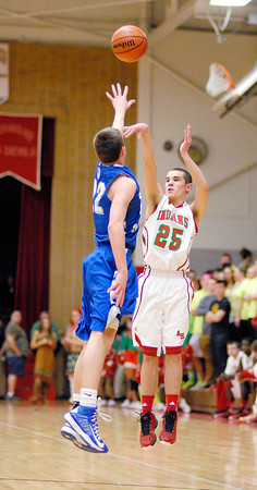 Anderson junior Grant Bennett shoots over the outsretched arm of a Chatard player.