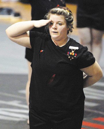 "A member of the Anderson High School Winter Guard salutes at the conclusion of ""The Wounded""."