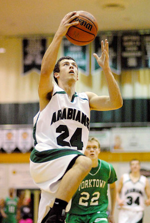 Pendleton Heights senior Brogan Gary goes in for a lay up during the Arabians home game against Yorktown High School.