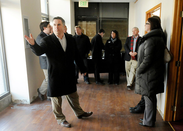 Principal broker Jeff Doner scans the room looking for bids as auctioneer Ted Pike auctions the Tower Apartments on Wednesday. The building sold for a bid of $100,000.