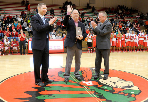The Herald Bulletin Sports Editor Rick Teverbaugh receives the IHSAA Distinguished Media Service Award for District 2 before Friday night's game between Anderson and Richmond.