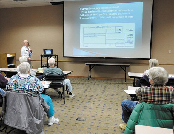 H&R Block Master Tax Advisor Dan Royer gives tips on doing your own taxes at the Anderson Public Library on Wednesday.