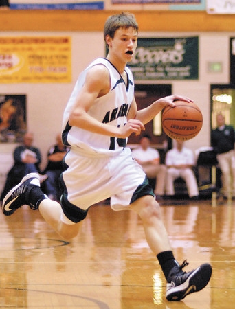 Pendleton Heights junior Levi Buck brings the ball downcourt during the Arabians home game against North Central High School.