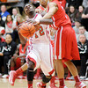 Anderson's Chris Lemon is fouled by Richmond's Davious Webster as he drives to the basket on Friday.