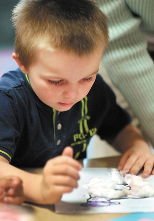 Anderson Elementary developmental preschool student Meredith Pitts works on a art project.