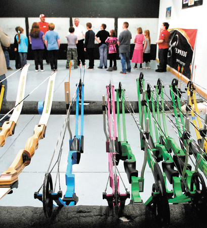 Madison County 4-H archery students receive instruction on the range before they pickup their bows on the first night of Madison County 4-H archery lessons Monday held at Girt's Archery in Anderson.