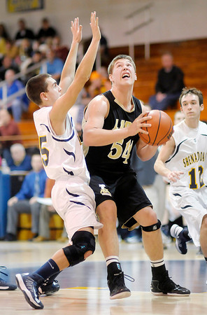 Lapel's Dane Mason pivots toward the basket in the low post as he is guarded by Shenandoah's Moose Kirk on Thursday.