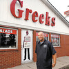 Greek's Pizzeria's operations manager Clay Sexton stands in front of their location at 6317 MLK Blvd. in Anderson.