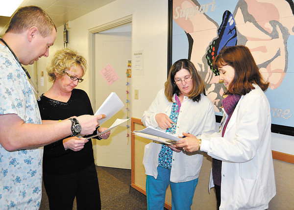 St. Vincent Anderson Regional Hospice program staff meet regularly to discuss patients' progress and cases. From left are Chris Arvin, Shelly Betz, Cheryl Herrington and Kathy Zehner.