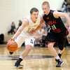 Lapel's Tanner Watkins brings the ball down court as he is guarded by Cardinal Ritter's Kevin Bacon on Friday.