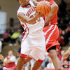 Anderson's Jalin Beard draws a foul from Richmond's Reggie Jones as he drives to the basket on Friday.