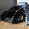 Carrie Conner washes her '98 Firebird at the Wash Tub Car Wash on Broadway on Wednesday. Local car washes were busy as people took advantage of the break in winter weather to wash their vehicles.