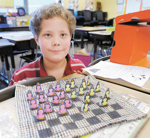 """Michael Phipps created a penguin checkers set to go along with his class reading the children's book """"Mr. Popper's Penguins."""""""