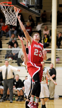 Frankton's Aaron Korn drives the baseline for a layup as the Daleville Broncos hosted the Eagles on Saturday.