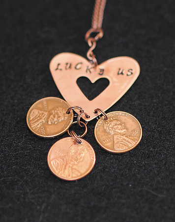 Robyn Bohlander made this charm from pinterest with pennies with special dates on them.