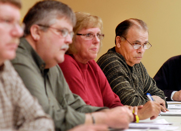 Lapel Town Council president Gary Shuck, right, along with the other members of the council listen to the questions and concerns of area residents during a  special meeting for input on Anderson's proposed annexation.