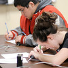 Frankton's Kelli Bankson works on a math problem during the Academic Brain Bowl at the Flagship Enterprise Center hosted by Purdue University College of Technology at Anderson on Saturday.