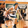 Pendleton Heights senior Brogan Gary drives past North Central player Wes Stowers.