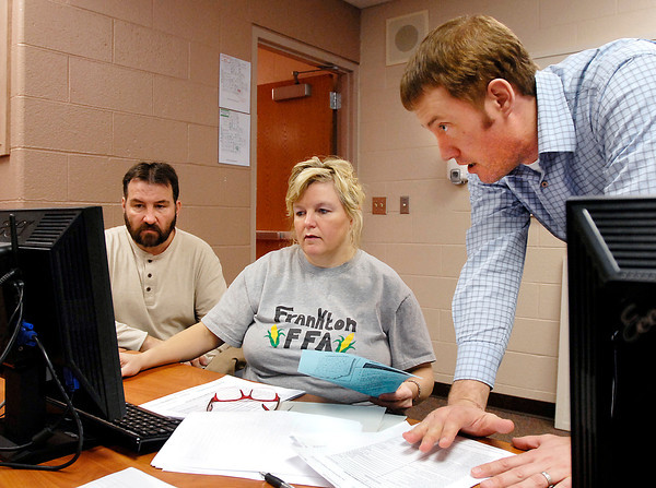 Bryan Murray, right, of The National Center for College Costs, assists Ron and Myra West as they go through the FAFSA program at Frankton Jr/Sr High School this past Wednesday at the FAFSA workshop held at the school.