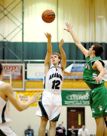 Pendleton Heights' Matt Brown takes a three point shot for the Arabians.