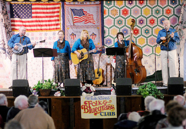 Cumberland Gap performs during the 24th Annual Snowflake Bluegrass Festival presented by the Whiteriver Folk and Bluegrass Club at the Rangeline Community Center on Saturday. Cumberland Gap was one of six bands to perform. From left are Danny Reneau, Jo Reneau, Angie Hensley, Ellen Davis and Bob Davis.