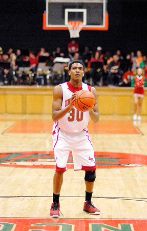 Armon Daniels keeps his eye on the basket while shooting a free throw during the second quarter of the Indians home game against Chatard.
